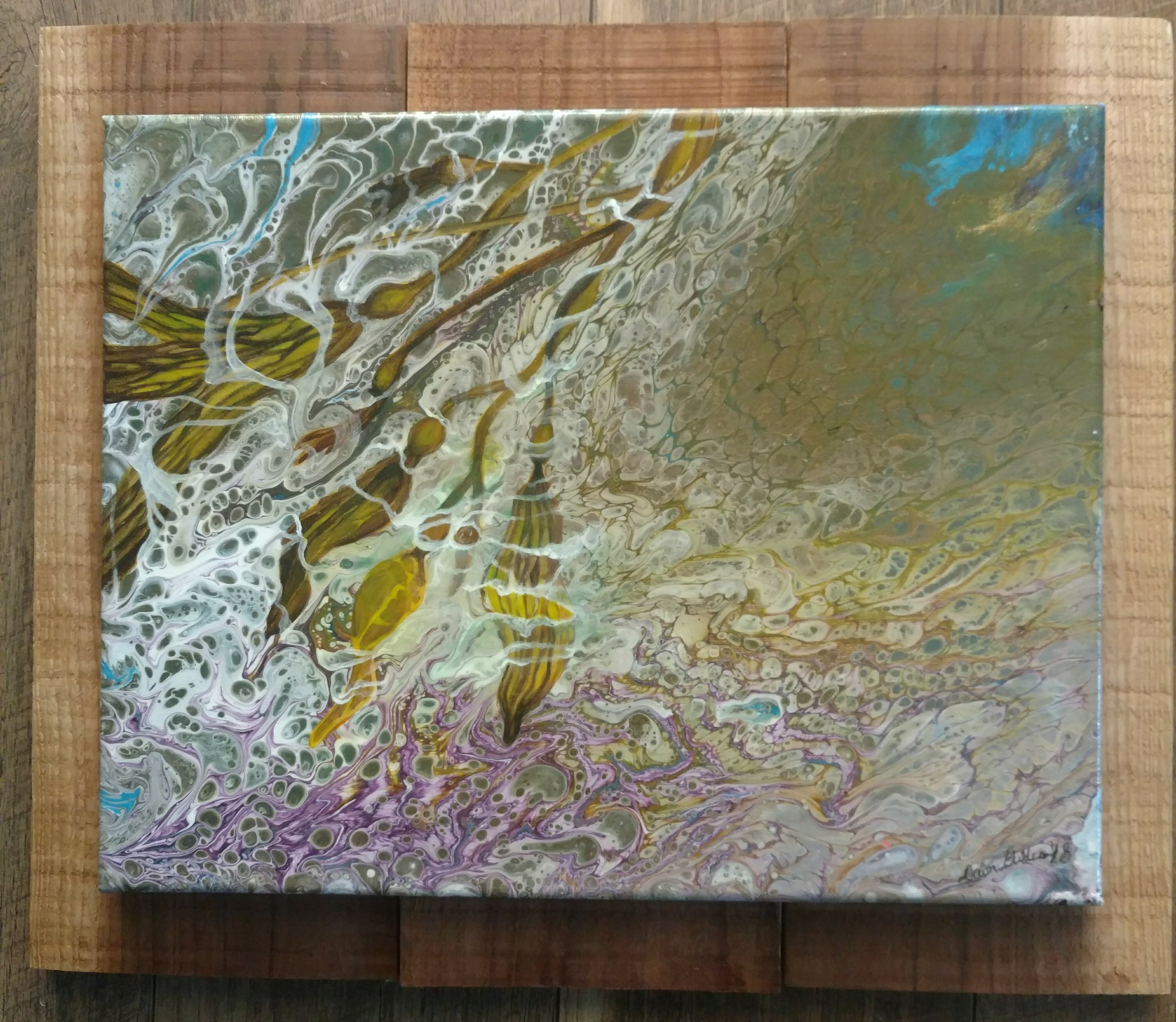 This is an acrylic pour with added seaweed detailed and sealed with poly acrylic.